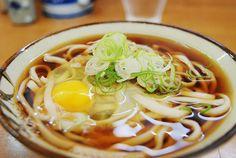 """月見うどん Tsukimi Udon: """"Moon-viewing udon"""". Topped with raw egg, which poaches in the hot soup."""