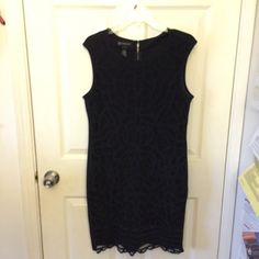 Black lace dress Black sleeveless lace dress.  Lace in front.  Zipper on back.  Stretchy material.  38 inches long.  Worn once.  Promise to ship out quickly! Dresses
