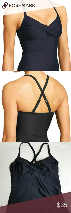 Athleta Twister Tankini This NWT tankin from Athleta is in the basic black that every women needs. It has a built-in underwire and adjustable straps for support and comfort. It has a twist front. The straps can be worn crossed or straight. The perfect basic! Athleta Swim Bikinis