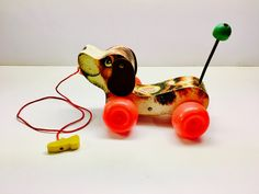 Vintage Snoopy Dog - Fisher Price Children's Dog Pull Toy - Vintage Pull Toy With Wagging Spring Tail. EXCELLENT CONDITION. by vintagetoolbox on Etsy