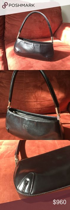 Vintage GUCCI handbag Gucci original made in black patent leather. Has the typical GG neat lines and metal hardware. Has the Double G pattern and one zipper pocket inside.  It is in good used condition. Very classy! A great item for collectors. Gucci Bags Mini Bags