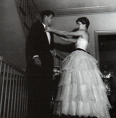John and Jackie Kennedy getting ready for a ball, 1950s.