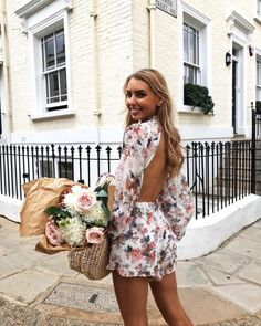 The cutest floral playsuit with long sleeves and an open back! This cute flowy romper outfit is the perfect Zimmerman dupe for just $20!