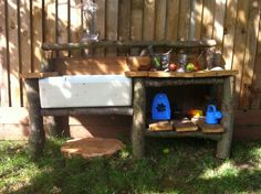 Mud kitchen in orchard. Made with deck screws logs and a Belfast sink. Mud kitchen in orchard. Outdoor Sinks, Diy Outdoor Kitchen, Kids Outdoor Play, Outdoor Play Areas, Outside Activities For Kids, Outdoor Activities, Mud Kitchen For Kids, Garden Sink, Butler Sink