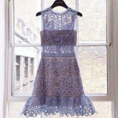 NEW  Crochet Lace A-line Dress Beautiful A line dress features crocheted lacey details on the exterior and chiffon lining. Sleeveless. Above knee length. Zipper closure in back. Single button at back of neck line. Feminine high neck. Brand new. Lavender color. Boutique Dresses Prom