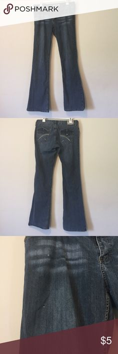Wide Leg Jeans Wide leg blue Jeans. Size 13 in juniors. Waist measurement is a 32. I wore them as work pants. A button is missing in the back and there is a small hole in the front and very small hole on the side. Just look through pics. YMI Jeans Flare & Wide Leg