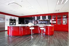 The darker vinyl flooring sets of the bright red units in this example kitchen at the new ft² Stellisons electrical superstore in Ipswich. Vinyl Flooring, Retail, The Unit, Kitchen Appliances, Bright, Red, Home Decor, Home, Diy Kitchen Appliances