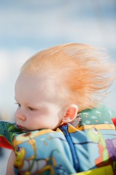 red head baby in the breeze