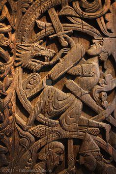 Sigurd kills the worm Fafnir; Hylestad stave church door