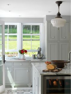Light grey cabinets and carrara counters are so soft and elegant.