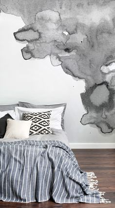 Dip into inky tones with this watercolor wallpaper. This gray wallpaper design is oozing with sophistication and style. Combine with linen sheets and a few statement cushions for that ultra comfy look. Perfect for modern bedroom spaces.