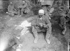 MINISTRY INFORMATION FIRST WORLD WAR OFFICIAL COLLECTION (Q 1314) Wounded German prisoner near Aveluy Wood, September 1916