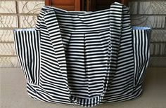 Just bought this darling diaper/overnight bag!  The stripes are so versatile and gender neutral :)