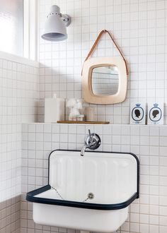 Bathroom detail.  Stanley Ruiz mirror, lamp sourced from Germany, collectable ceramics from Royal Copenhagen.  Photo - Sean Fennessy, production – Lucy Feagins / The Design Files.