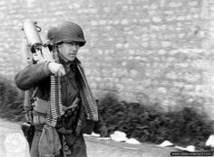 WWII Utah Beach D-Day June 1944 - Soldier of the Battalion, Infantry Regiment, Infantry Division, carrying a Browning near the Lieutenant Matz command post at La Madeleine. Military Units, Military Photos, Military History, Ww2 Photos, History Photos, Photos Du, Ww2 Pictures, Browning, D Day 1944