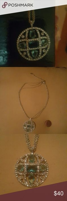 Beautiful necklace.. Elegant round necklace... with aqua and diamond looking crystals ... chain is a triple short chain.. its brand new .. but no tags ... Jewelry Necklaces