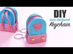 Supplies Needed: Glitter foam sheet Glue gun Zip Silver thread Ruler Marker Keychain ring Jump rings Some decor DIY Mini Pouch Bag Keychain. Diy Bag Keychain, Backpack Keychains, Keychain Ideas, Diy Crafts For Gifts, Craft Stick Crafts, Paper Crafts, Monkey Crafts, Easy Diy Gifts