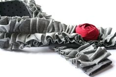 ruffled camera strap cover with rosette detail.