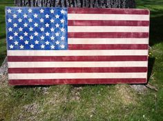 My neighbor and friend--and she's donating a % of the cost to Wounded Warrior--26 x 48 Hand painted indoor american flag - $99 on etsy from WrightAwayDesigns (USMC wife)