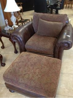 Neutral toned leather and chenille accent chair will blend well with existing decor. This comfy over sized chair is in impeccable condition!! Don't let this one get by you!! Coordinating sofa and ottoman also available.      Yesterdays Treasures Consignment    5829 Lone Tree Way Suite J    Antioch    925 - 233 - 4547