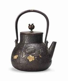 A JAPANESE INLAID BRONZE TEAPOT AND COVER MEIJI PERIOD (1868-1912)