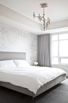 Modern silver gray bedroom with silver metallic wallpaper accent wall, gray linen modern bed, crisp white hotel bedding with white stitching, lilac gray curtains window panels and polished nickel winding Omega Chandelier. White And Silver Bedroom, Gray Bedroom, Trendy Bedroom, Master Bedrooms, Bedroom Colors, Feminine Bedroom, Master Suite, Grey Velvet Curtains, Gray Curtains