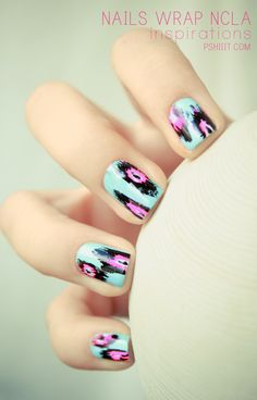 Light teal and pink nails.
