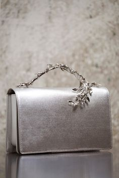 The Eden Eclipse Bag is part of an exclusive preview of our new Accessories collection, as featured in the AW16/17 Couture Show. For more information about the launch date and availability of this piece, please get in touch.