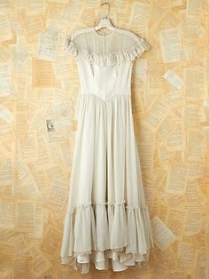 Vintage White Ruffled Maxi Dress. http://www.freepeople.com/vintage-loves-pretty-in-pink/vintage-white-ruffled-maxi-dress-26901371/