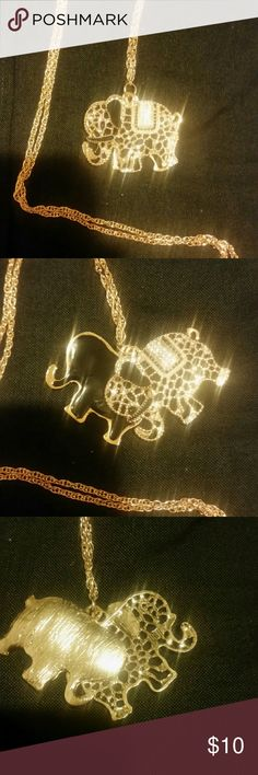 Elephant sweater necklace Elephant sweater necklace fashion necklace the necklace is gold colored 27 inches long with crystals Jewelry Necklaces