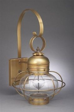 Caged Onion Wall With Galley Verdi Gris Medium Base Socket Clear Glass by Northeast Lantern. $476.00. Northeast Lantern 2531G This lighting fixture is hand made in New Hampshire from 100% brass or copper materials. Includes a lifetime guarantee, except for glass. UL Listed. The all natural finish that will not peel or flake off. Features: -Wall lantern. -Onion collection. -Available in Antique Brass, Dark Antique Brass, Dark Brass, Raw Brass and Verdi Gris finis...