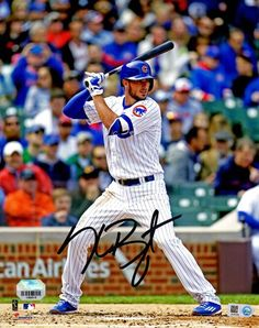Kris Bryant signed Chicago Cubs batting action 8x10 photo. Item comes with the MLB Hologram and a Fanatics Authentics tamper-proof numbered hologram and Certificate of Authenticity which can be verifi