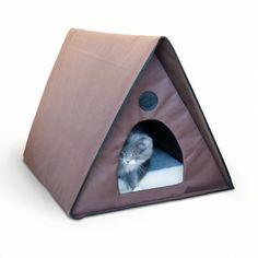 An outdoor heated kitty house that can hold multiple cats. Waterproof fabric and protective overhang keep cats dry and warm.