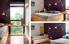O quarto foi projetado para receber os filhos. As camas se multiplicam, com bicamas embutidas, mas a esperteza do projeto mora em outro lugar: de cada parede natural, desce um tampo de madeira carvalho, sustentado por cabo de a�o. Ideia do Est�dio Cada Um
