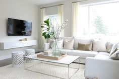 Beautiful Living Room Features A White Sectional Lined With Pale Pink  Velvet Pillows As Well As