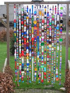 ... a bit of garden whimsy ... made of bottle caps..& all type of caps