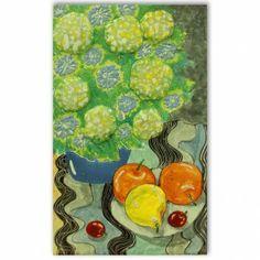 Fruits beside the flower vase.