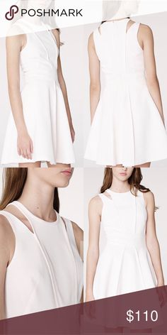 ARMANI EXCHANGE - CUTOUT SHOULDER FIT-AND-FLARE Contoured shoulder cutouts give a modern edge to the classically feminine fit-and-flare. A/X Armani Exchange Dresses Midi