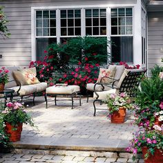 Awesome setting . . . The living room terrace is dedicated to relaxing and socializing, with comfortable furniture that creates a relaxed environment. This is also the central space of the patio, with an entrance to the home through French doors, as well as step-down access to the other terraces.