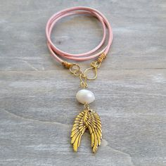 Triple wrap pink leather angel wings bracelet, converts into necklace for double the fun!