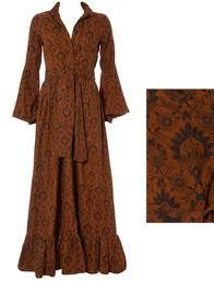 laura ashley dress. Love this seventies flashback, especially the wide sleeves. Fabric pattern is divine.