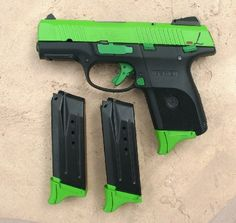 Ruger SR9c with a Zombie Green slide and mag bases, custom lettering, with Everglades controls