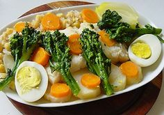 'Bacalhau cozido com todos' - boiled cod, served with chick peas, boiled potatoes, boiled eggs and vegetables.