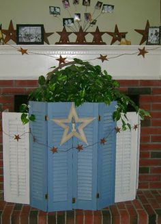 Fireplace screen using old shutters.