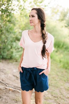 Light pink, oversized v neck tee with a pocket  Model is 5'10'' wearing size Small