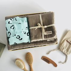 A modern option to the traditional baby gift hamper. Everything beautifully arranged in our luxury gift box. * 4-layer 100% cotton muslin breathable blanket set in Cocoa with a contrast cream scalloped lace trim. Measures large 130x130cm/ Small 60x50cm. * Pull-on cotton sweatshirt with all over delicate animal print. Unisex design. Plain ribbed cuff and waist band. * Goat hair and beech wood baby brush set in linen drawstring bag. * All orders arrive beautifully gift wrapped in our Deluxe… Baby Gift Hampers, Baby Hamper, Baby Gift Sets, New Baby Gifts, Cotton Muslin, Baby Arrival, Newborn Baby Gifts, Scalloped Lace, New Parents