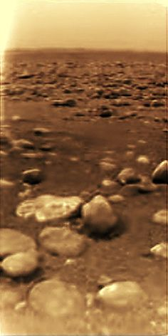 An image from the surface of Titan (Saturn Moon with lakes/oceans) — the only image from the surface of an object farther away than Mars. - Imgur