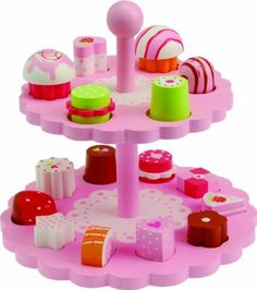 """Sweet Treats by CP Toys by Constructive Playthings. Save 20 Off!. $31.88. 17 piece set. Wooden treats. 16 individual wooden confections (cupcakes, petit fours).. This is a CP Toys exclusive item! This 17 piece set of wooden sweet treats comes with 16 individual treats that fit into their personal shaped spots, perfect for your little puzzle solver, as well as, a 2-tiered stand. The tiered service stand measures 9""""H x 9 1/2"""" diameter. Some assembly is required. This sweet treats sets pairs…"""