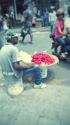 "A fruit seller on a warm summer day in Mauritius, selling ""zen balack"""