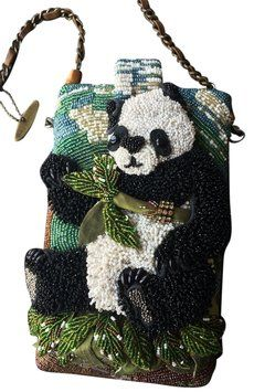 Mary Frances Posh Panda Black, White, Green, Gold Clutch. Get the trendiest Clutch of the season! The Mary Frances Posh Panda Black, White, Green, Gold Clutch is a top 10 member favorite on Tradesy. Save on yours before they are sold out!